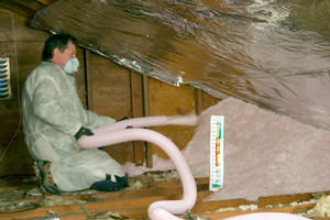 Fiberglass Insulation being used to add energy efficiency to an attic in Laurel